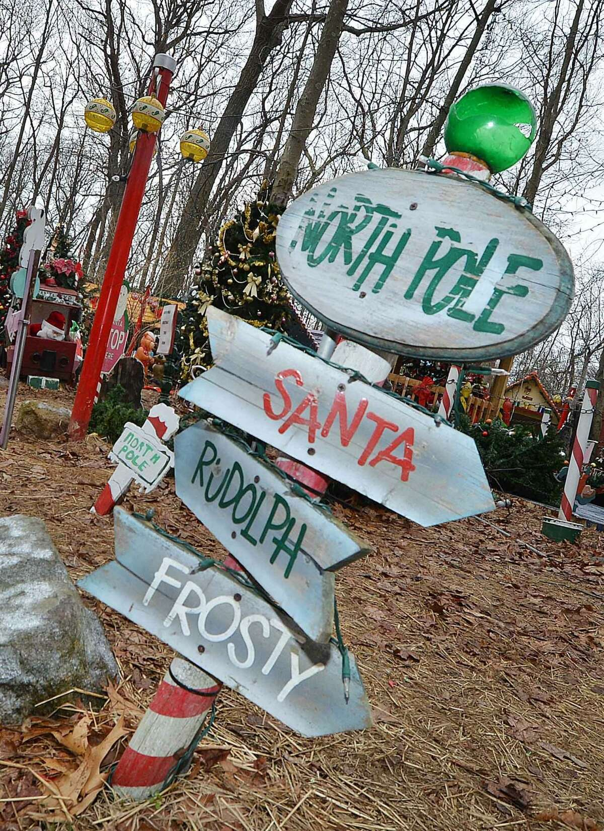 Hour Photo/Alex von Kleydorff Rick and Joan Setti will hold a tag sale to sell the items they have built and displayed over the last 26 Holiday's at their Norwalk home. This signpost has directed people for years throught the extensive display