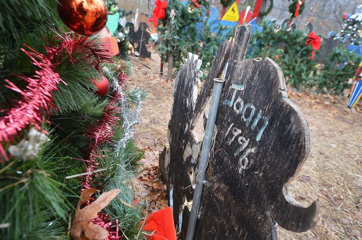 Hour Photo/Alex von Kleydorff Rick and Joan Setti will hold a tag sale to sell the items they have built and displayed over the last 26 Holiday's at their Norwalk home. A signed elf from 1996 as the year it was made