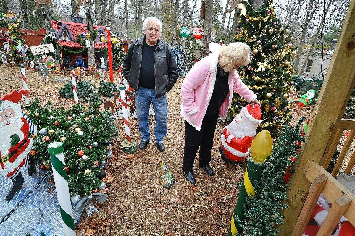 Hour Photo/Alex von Kleydorff Rick and Joan Setti will hold a tag sale to sell the items they have built and displayed over the last 26 Holiday's at their Norwalk home, Joan straightens a Santa as they walk through the display