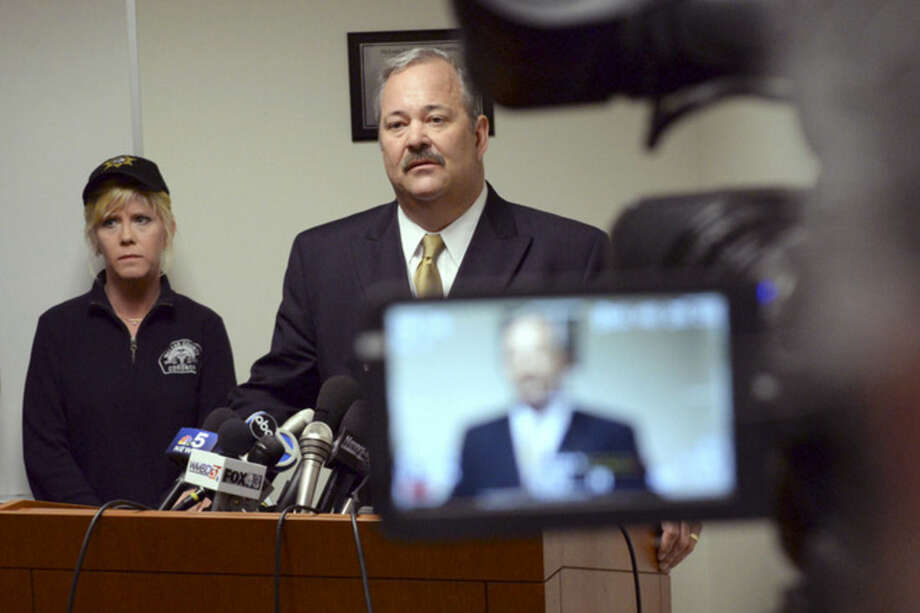 Central Illinois Regional Airport executive director Carl Olson and McLean County Coroner Kathy Davis answer a reporters question concerning a plane crash on Tuesday, April 7, 2015 in Bloomington, Ill. A small private plane returning from the NCAA basketball tournament in Indianapolis crashed in a central Illinois field killing all seven people on board. Rescue personnel found no survivors at the site near Bloomington, and a coroner pronounced the seven occupants dead, McLean County Sheriff's Department Sheriff Jon Sandage said. (AP Photo/The Pantagraph, Steve Smedley)