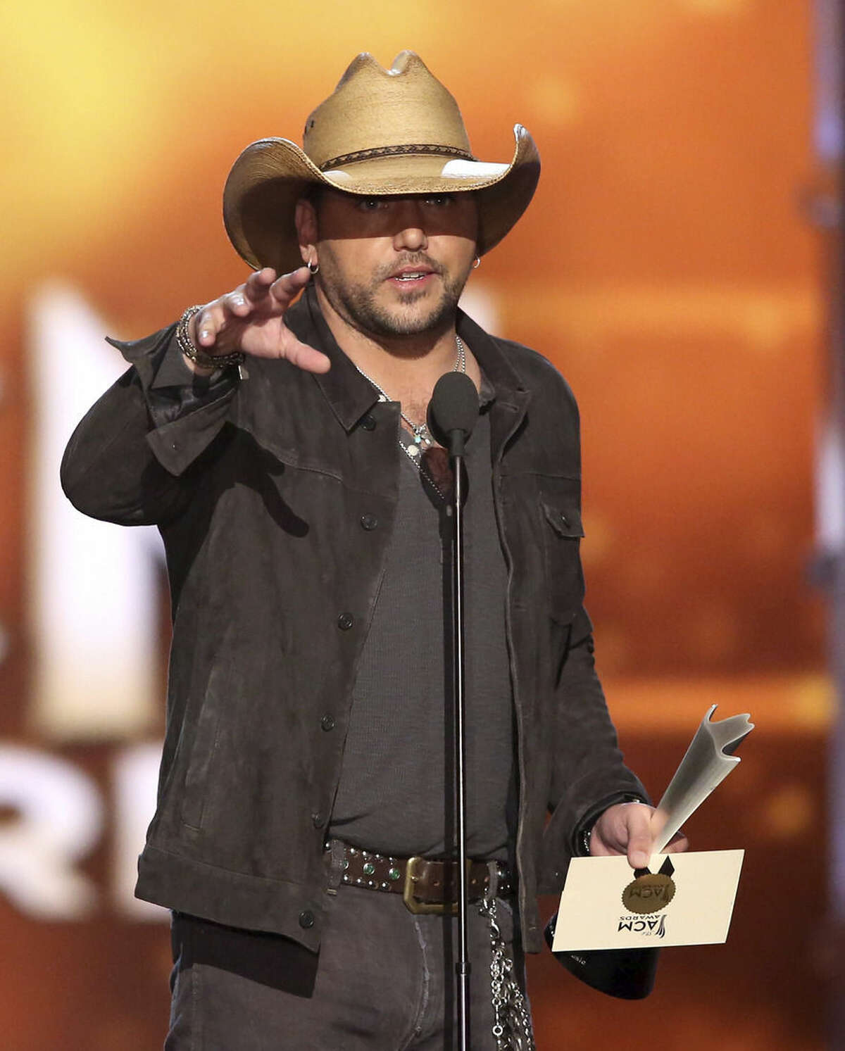 Jason Aldean accepts the award for entertainer of the year at the 51st annual Academy of Country Music Awards at the MGM Grand Garden Arena on Sunday, April 3, 2016, in Las Vegas. (Photo by Matt Sayles/Invision/AP)