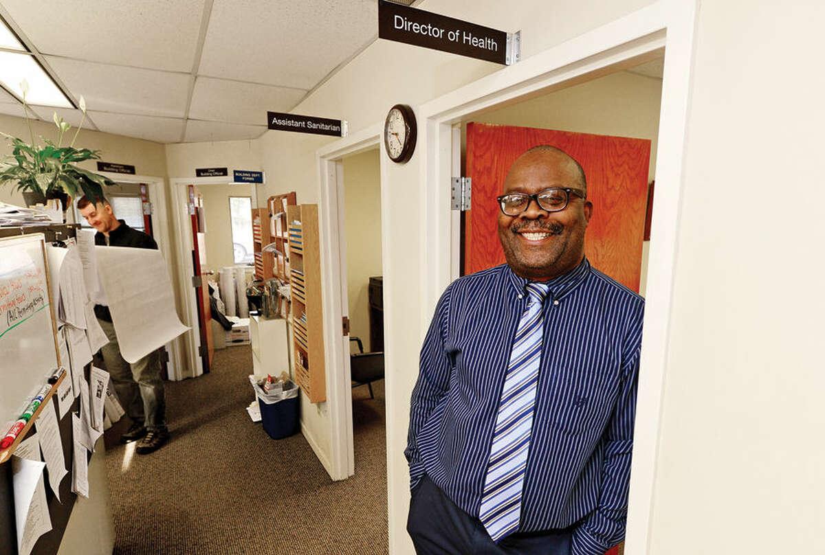 Wilton's Director of Health Barrington Bogle stands in the doorway of his office.