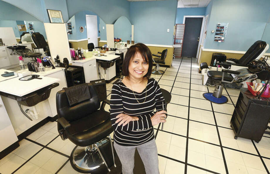Hour photo/Erik TrautmannGeeta Sheth, owner of Hair Today which is celebrating its 15th anniversary in Norwalk next week.