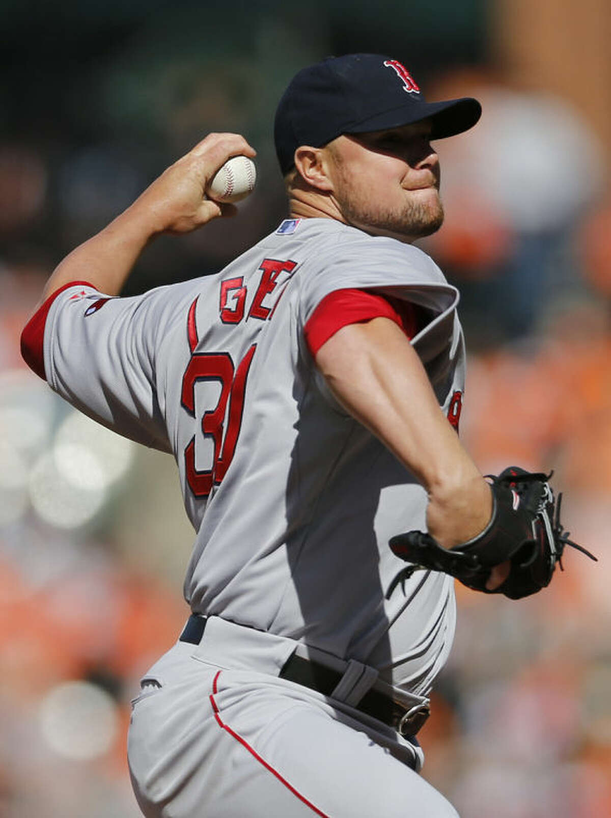 Boston Red Sox starting pitcher Jon Lester throws to the Baltimore Orioles in the first inning of an opening day baseball game, Monday, March 31, 2014, in Baltimore. (AP Photo/Patrick Semansky)