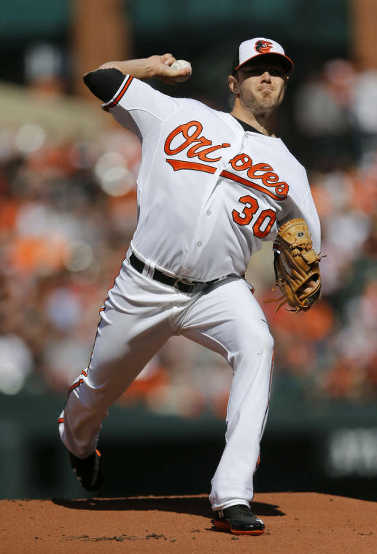 Baltimore Orioles starting pitcher Chris Tillman throws to the Boston Red Sox in the first inning of an opening day baseball game, Monday, March 31, 2014, in Baltimore. (AP Photo/Patrick Semansky)