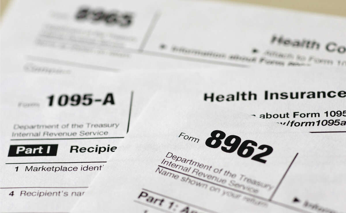AP Photo/Carolyn Kaster, File In this Aug. 21, 2014 file photo, health care tax forms 8962, 1095-A, and 8965, are seen in Washington.