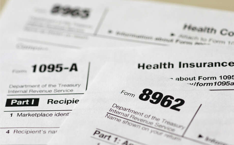 AP Photo/Carolyn Kaster, FileIn this Aug. 21, 2014 file photo, health care tax forms 8962, 1095-A, and 8965, are seen in Washington.