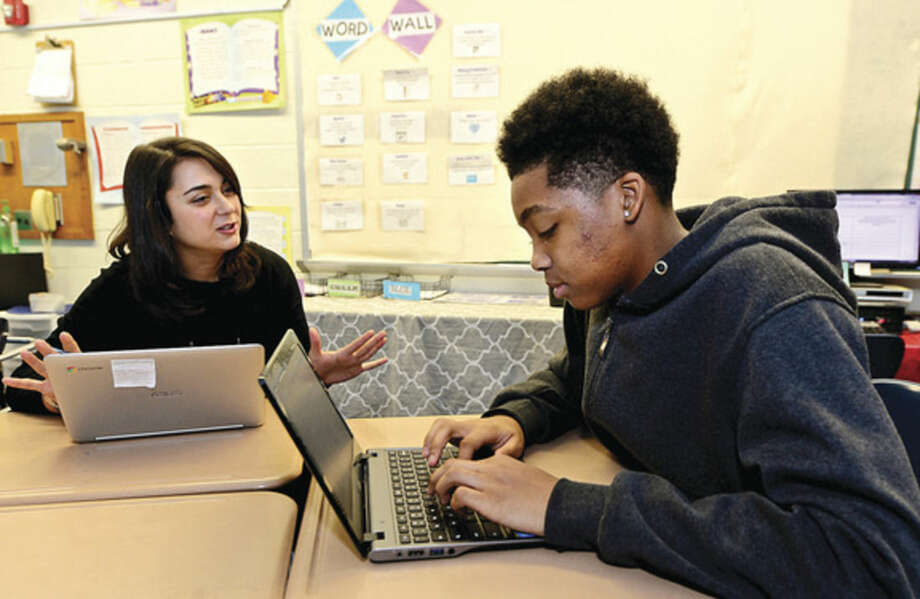 Hour photo / Erik TrautmannPonus Ridge Middle School teacher Ashley Bonora instructs 8th grader Tad Carr during her paperless Language Arts class Thursday.