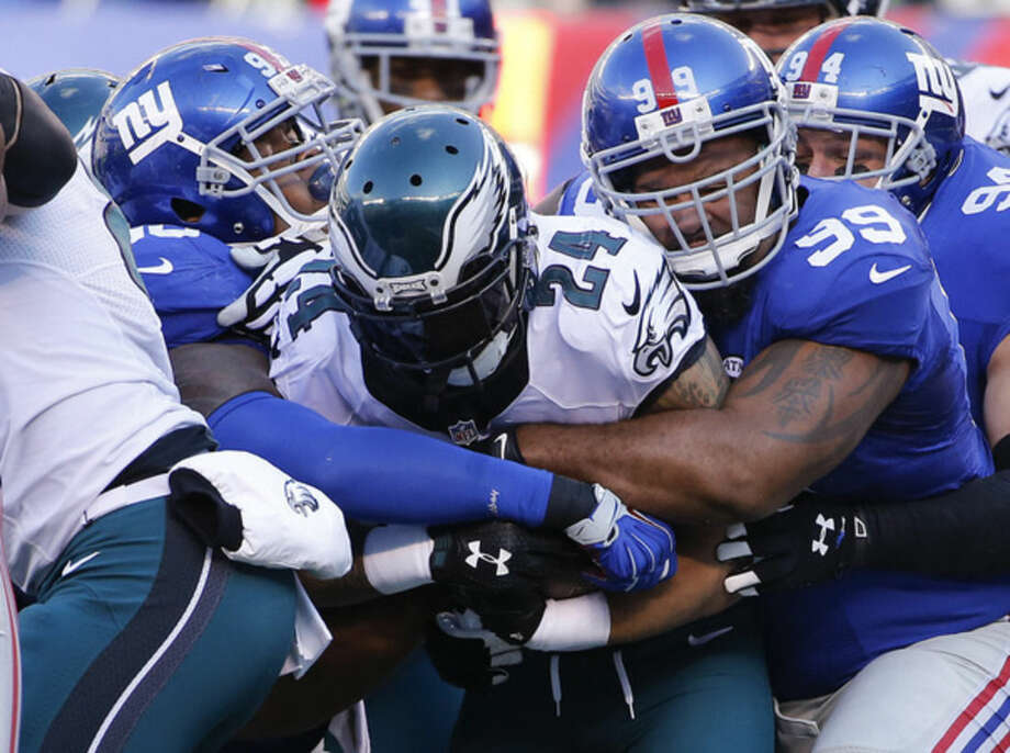 Philadelphia Eagles running back Ryan Mathews (24) is tackled by the New York Giants during the first quarter of an NFL football game, Sunday, Jan. 3, 2016, in East Rutherford, N.J. (AP Photo/Kathy Willens)