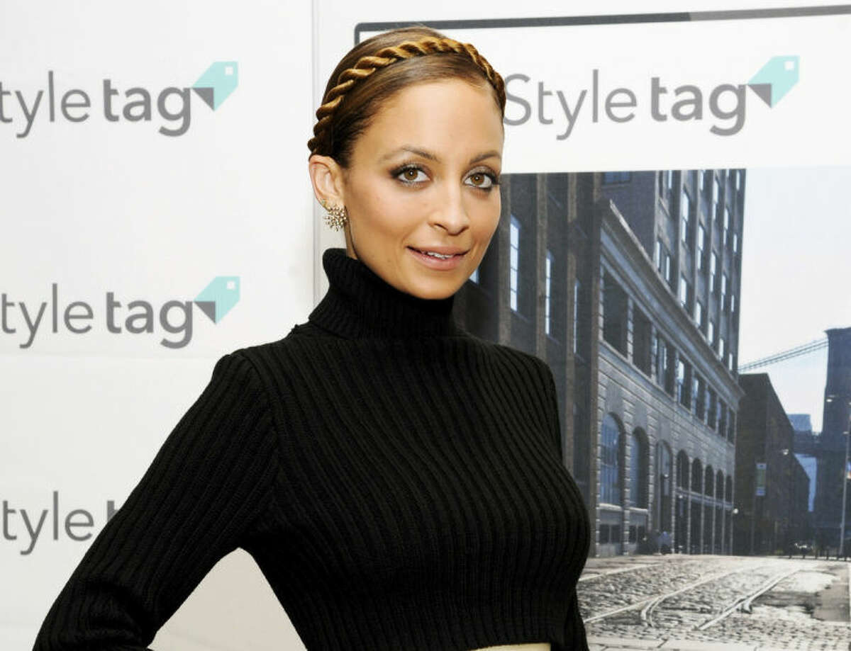 FILE - This Dec. 6, 2013 file photo shows TV personality and fashion designer Nicole Richie at the launch of SK Planet's Styletag fashion app at Henri Bendel in New York. Richie's #CandidlyNicole, based on her popular AOL web series, is coming to VH1 and will feature 8 new episodes premiering July 17. (Photo by Evan Agostini/Invision/AP, File)