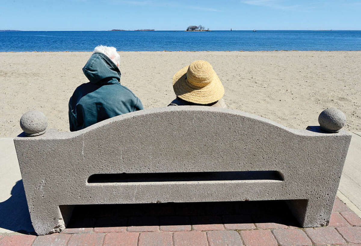 Hour photo / Erik Trautmann Longtime Norwalk residents Ralph and Jenny Vagnone enjoy the sunny Spring day at Calf Pasture Beach Tuesday.