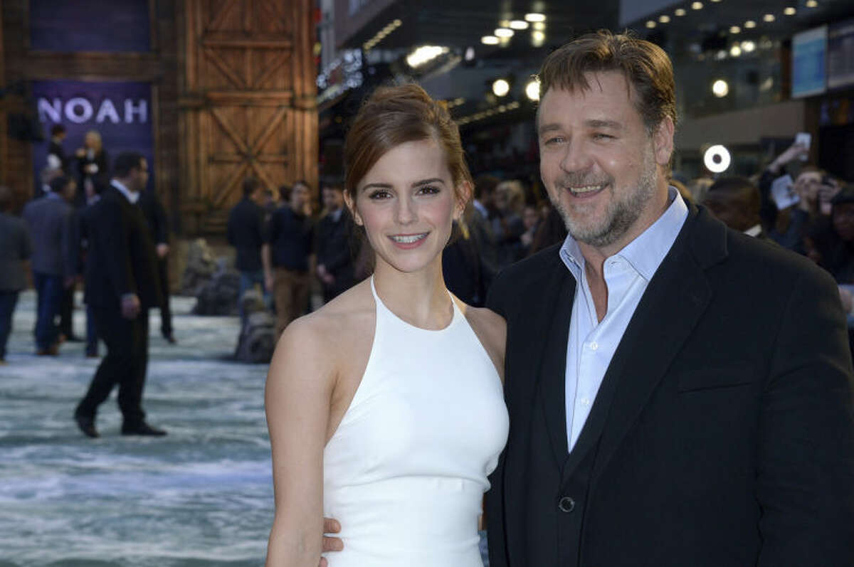 British actress Emma Watson and Australian actor Russell Crowe pose for photographers as they arrive at the UK premiere of Noah in Leicester Square, London, Monday March 31, 2014. (Photo by Jon Furniss/Invision/AP)