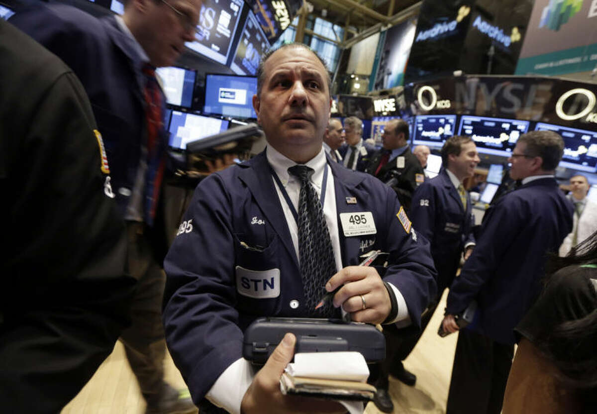 AP photo Trader Joel Luccese, center, works on the floor of the New York Stock Exchange.