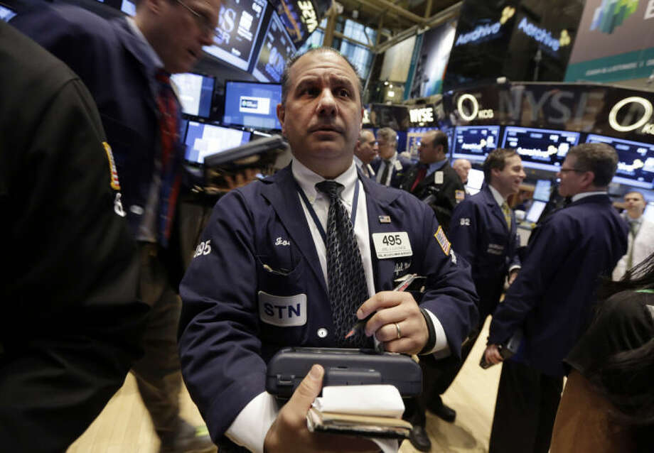 AP photoTrader Joel Luccese, center, works on the floor of the New York Stock Exchange.