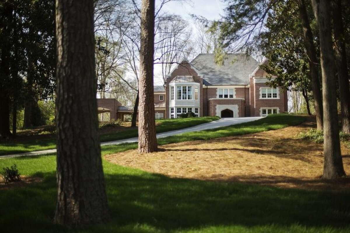 In this March 31, 2014, photo the new $2.2 million mansion that is the residence of Atlanta Archbishop Wilton Gregory stands in the upscale Buckhead neighborhood in Atlanta. Gregory apologized for his spending and offered to put the home up for sale after Pope Francis permanently removed a German bishop for his lavish spending on a renovation project. (AP Photo/David Goldman)