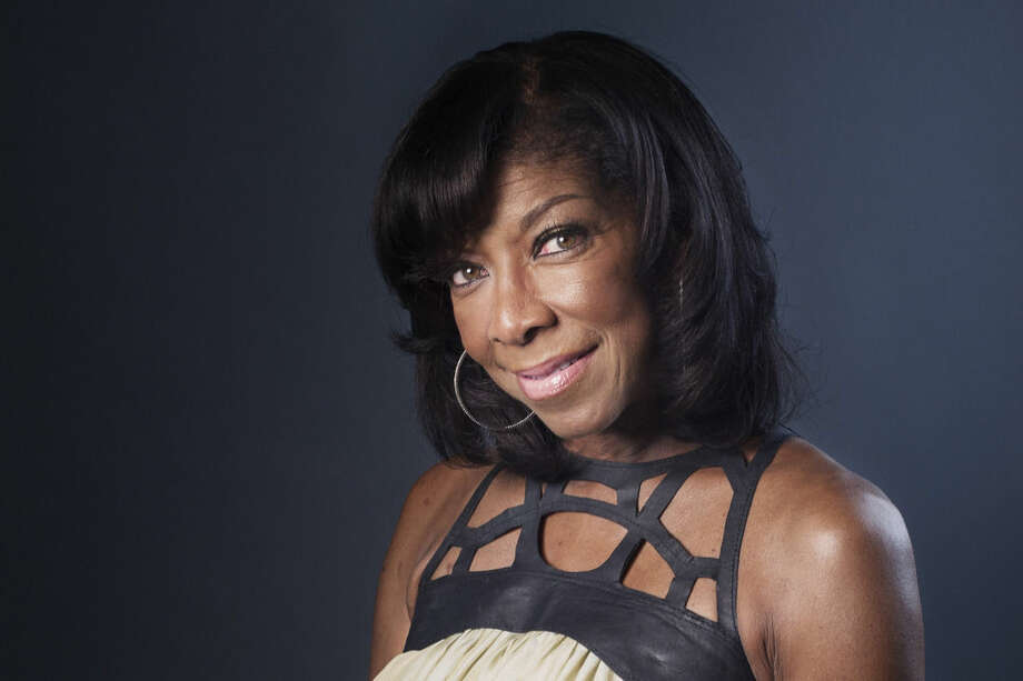 """FILE- In a Wednesday, June 26, 2013 file photo, Grammy winning singer-songwriter Natalie Cole poses for a portrait in promotion of her new album """"Natalie Cole en Espanol,"""" in New York. Cole, the daughter of jazz legend Nat """"King"""" Cole who carried on his musical legacy, died Thursday night, Dec. 31, 2015, according to publicist Maureen O'Connor. She was 65. (Photo by Victoria Will/Invision/AP, File)"""