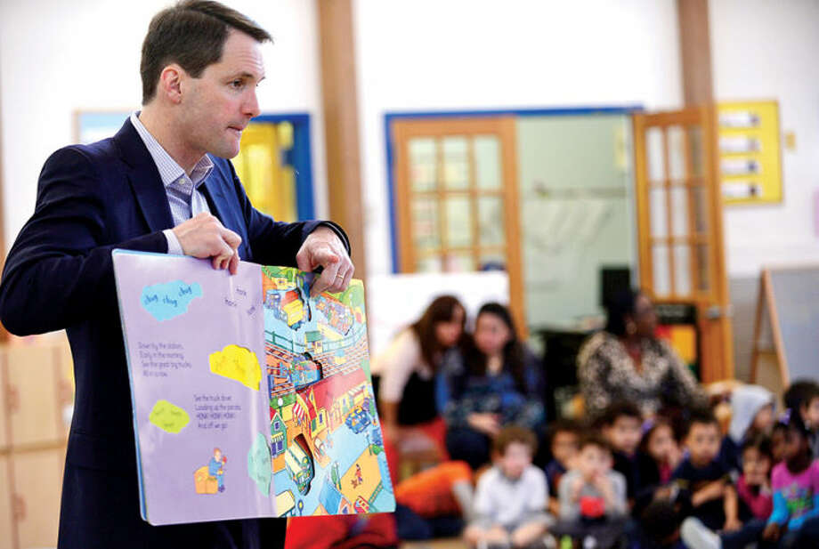 Hour photo / Erik Trautmann US Congressman Jim Himes (D-4) visits Childcare Learning Centers in Stamford Tuesday morning to read stories to the children there in recogniton of the upcoming Week of the Young Child (April 6-12). Week of the Child is an annual celebration focusing public attention on the needs of young children and their families. Childcare Learning Centers has provided childcare and early childhood education and development programs for Stamford's working families for over 100 years.