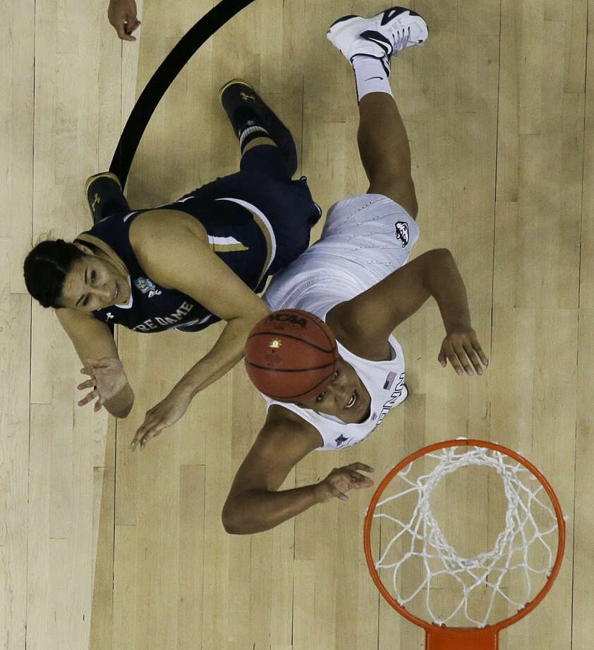 Connecticut forward Kaleena Mosqueda-Lewis (23) shoots as Notre Dame forward Taya Reimer (12) defends during the first half of the NCAA women's Final Four tournament college basketball championship game, Tuesday, April 7, 2015, in Tampa, Fla. (AP Photo/Brynn Anderson)