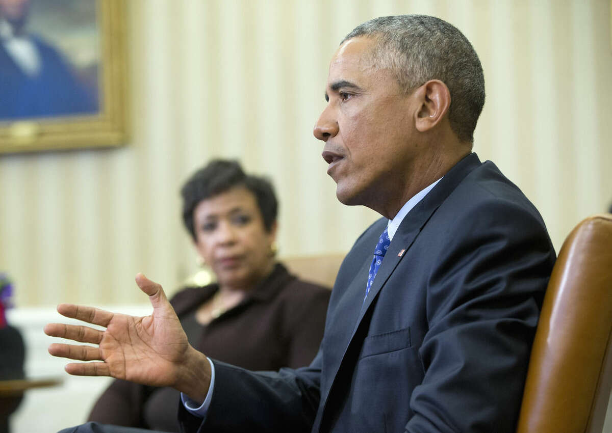 Attorney General Loretta Lynch listens as President Barack Obama speaks in the Oval Office of the White House in Washington, Monday, Jan. 4, 2016, during a meeting with law enforcement officials to discuss executive actions the president can take to curb gun violence. The president is slated to finalize a set of new executive actions tightening U.S. gun laws, kicking off his last year in office with a clear signal that he intends to prioritize one of the country's most intractable issues. (AP Photo/Pablo Martinez Monsivais)