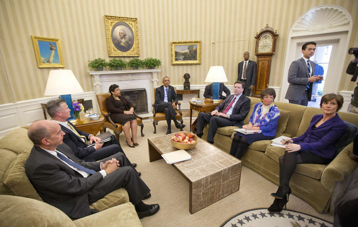President Barack Obama meets with top law enforcement officials in the Oval Office of the White House in Washington, Monday, Jan. 4, 2016, to discuss executive actions the president can take to curb gun violence. The president is slated to finalize a set of new executive actions tightening U.S. gun laws, kicking off his last year in office with a clear signal that he intends to prioritize one of the country's most intractable issues. From left are: Counsel to the President Neil Eggleston, acting ATF Director Thomas Brandon, Attorney General Loretta Lynch, FBI Director James Comey, White House Senior Adviser Valerie Jarrett, and Deputy Attorney General Sally Yates, (AP Photo/Pablo Martinez Monsivais)