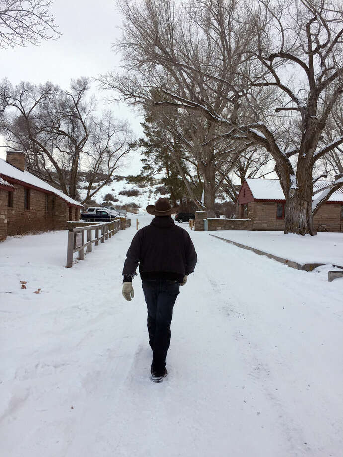 Ryan Bundy walks at the Malheur National Wildlife Refuge near Burns, Ore., Sunday, Jan. 3, 2016. Bundy is one of the protesters occupying the refuge to object to a prison sentence for local ranchers for burning federal land. (AP Photo/Rebecca Boone)