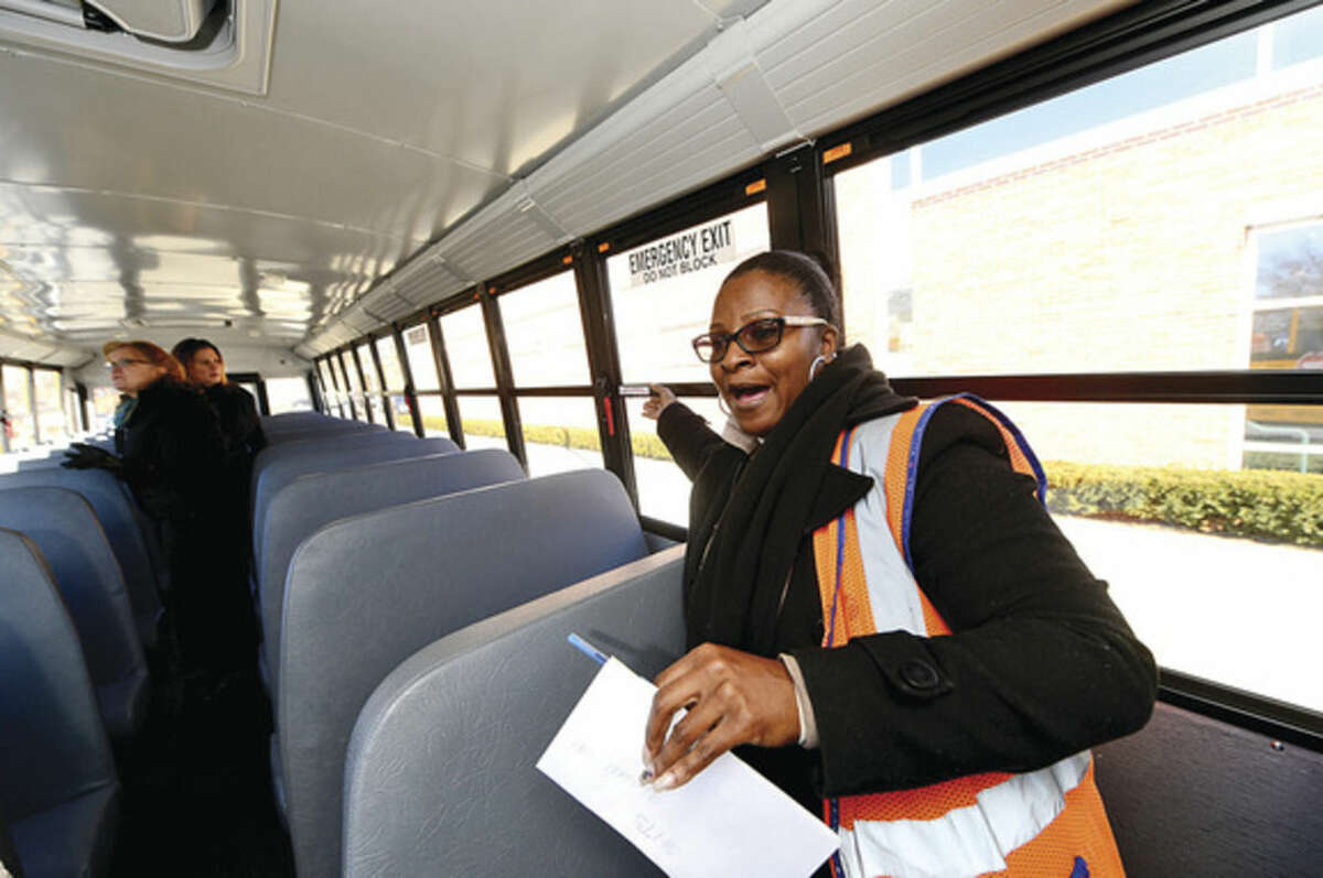 Hour photos/Erik Trautmann First Student Safety Manager Benita Hargett talks about improved safety features in the new Thomas Built SAF-T-LINER® C2 school buses that went into service this week.