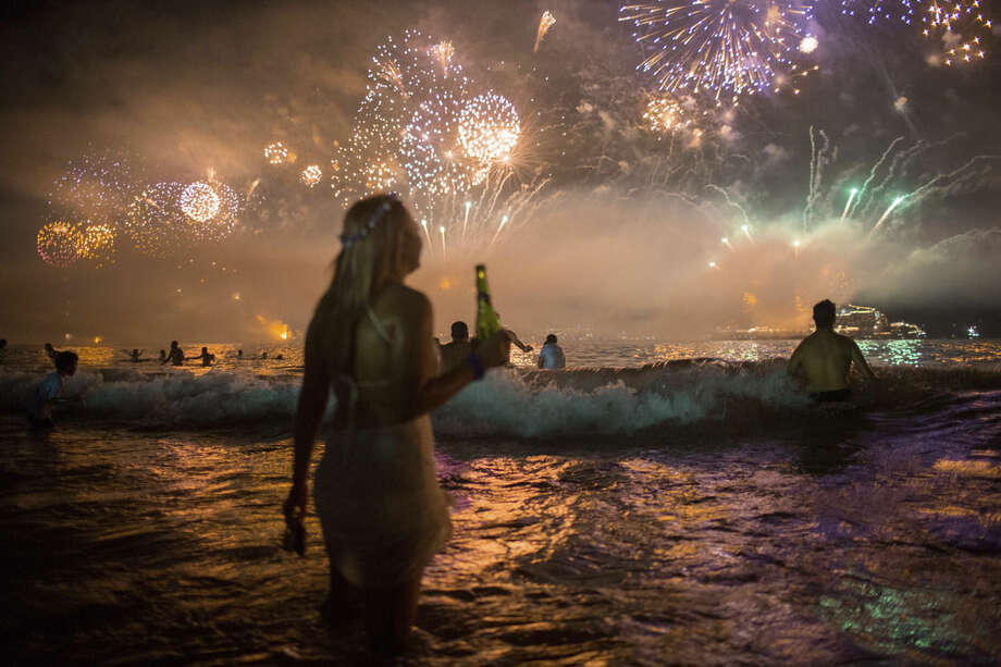 Fireworks light the sky over Copacabana beach during New Year's Eve celebrations in Rio de Janeiro, Brazil, Thursday, Jan. 1, 2016. (AP Photo/Mauro Pimentel)