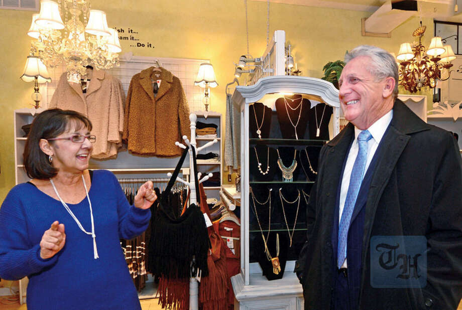 Hour photo / Erik Trautmann Owner of Connoe B's boutique on North Main St. in SoNo, Connie Briown, welcomes Norwalk Mayor Harry Rilling as the mayor tours a different