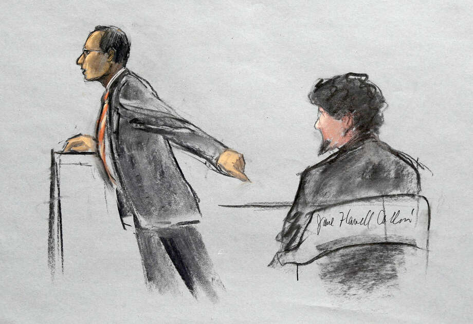 In this courtroom sketch, Assistant U.S. Attorney Aloke Chakravarty is depicted pointing to defendant Dzhokhar Tsarnaev, right, during closing arguments in Tsarnaev's federal death penalty trial Monday, April 6, 2015, in Boston. Tsarnaev is charged with conspiring with his brother to place two bombs near the Boston Marathon finish line in April 2013, killing three and injuring 260 people. (AP Photo/Jane Flavell Collins)