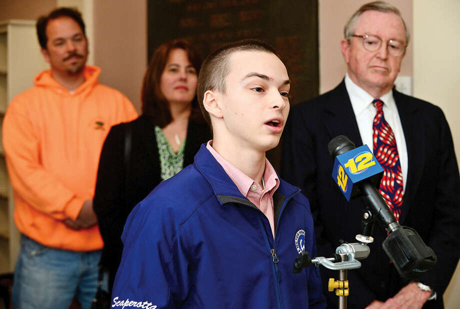 Hour photo / Erik Trautmann Wilton High School sophmore Alex Wilton Go Green press conference at Wilton Town Hall Wednesday.