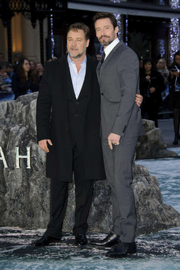 From left, New Zealand actor Russell Crowe and Australian actor Hugh Jackman arrive for the UK Premiere of Noah at a central London cinema, London, Monday, March 31, 2014. (Photo by Jonathan Short/Invision/AP)