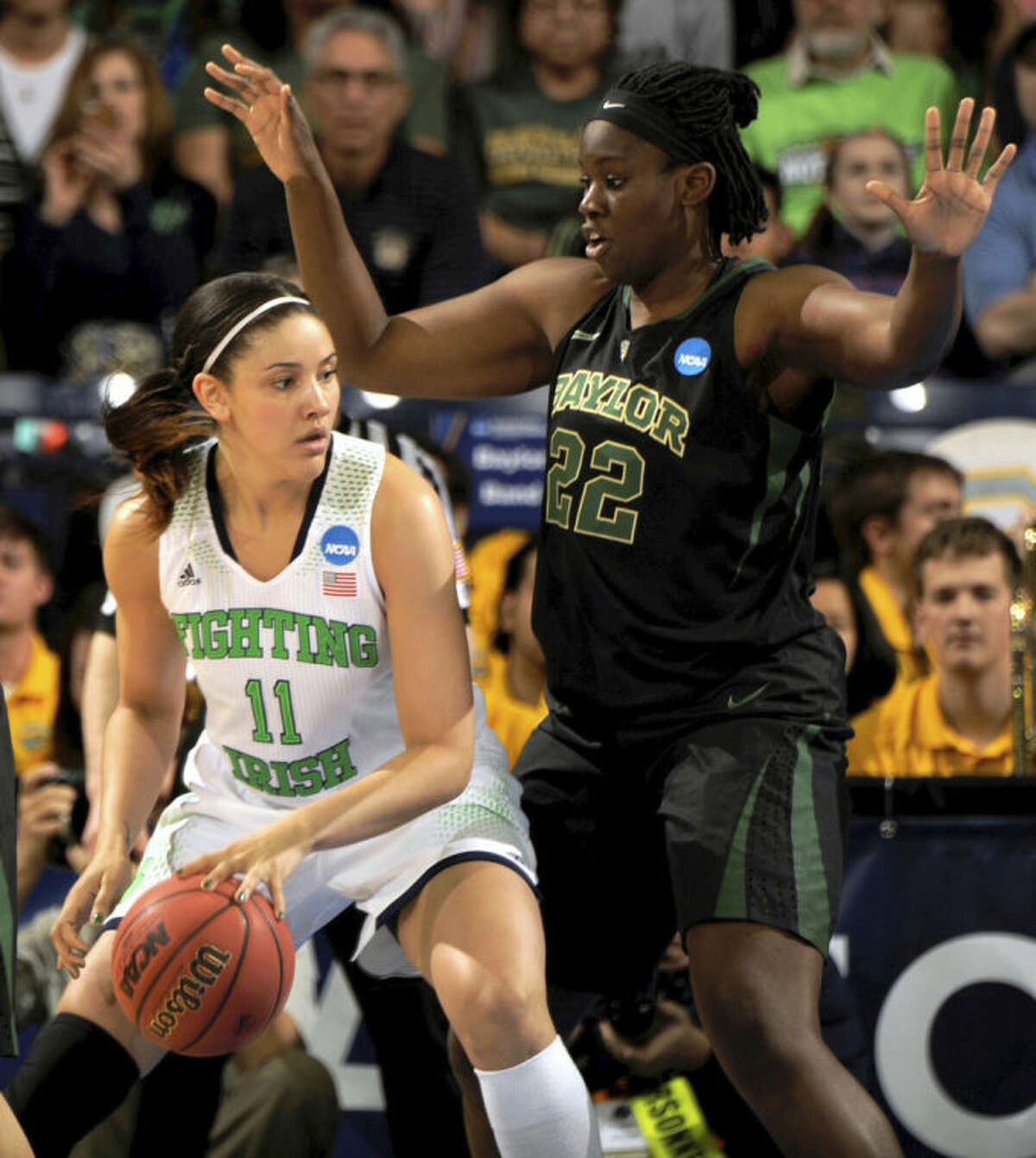 Notre Dame forward Natalie Achonwa drives the lane as Baylor center Sune Agbuke defends in the first half of their NCAA women's college basketball tournament regional final game at the Purcell Pavilion in South Bend, Ind., Monday March 31, 2014. (AP Photo/Joe Raymond)
