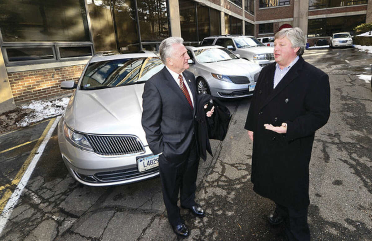 Hour photo / Erik Trautmann Norwalk Mayor Harry Rilling meets with Teddy's Transportation System Inc. President and CEO Charles Wisniewski as part of the mayor's small business initiative Wednesday.