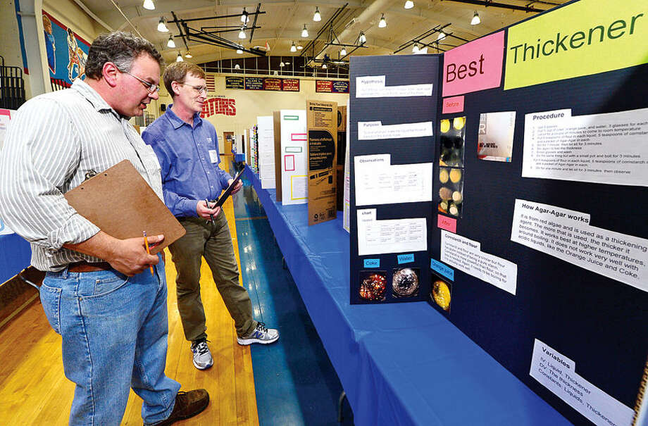 Hour photo / Erik Trautmann Brien McMahon High School hosts the Norwalk Public Schools District-Wide Science Fair Wednesday. More than 400 science projects from students in grade K-12 have were on display since Monday.