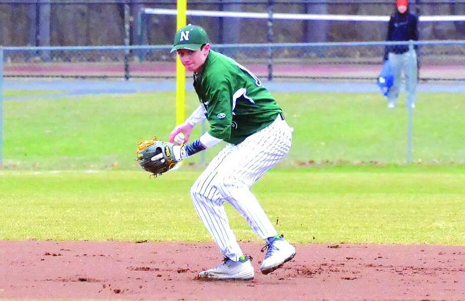 Norwalk shortstop Eddie McCabe fields a ground ball before throwing out a runner. (Pete Paguaga/Hour photo)