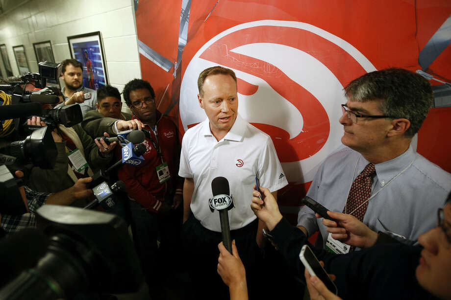Atlanta Hawks coach Mike Budenholzer answers a question during his pre-game news conference before an NBA basketball game between the Atlanta Hawks and the Brooklyn Nets Wednesday, April 8, 2015, in New York. (AP Photo/Jason DeCrow)