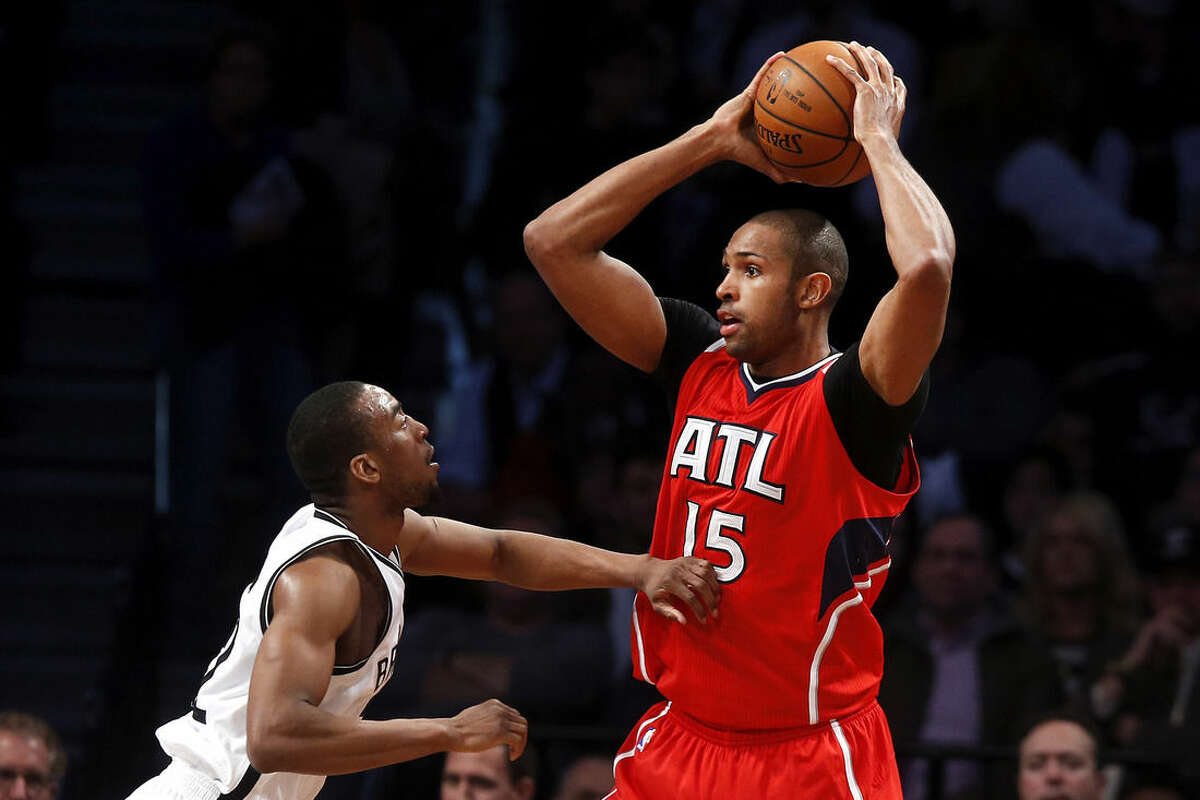 Atlanta Hawks' Al Horford (15) works in the post against Brooklyn Nets' Markel Brown, left, during the second quarter of an NBA basketball game Wednesday, April 8, 2015, in New York. (AP Photo/Jason DeCrow)