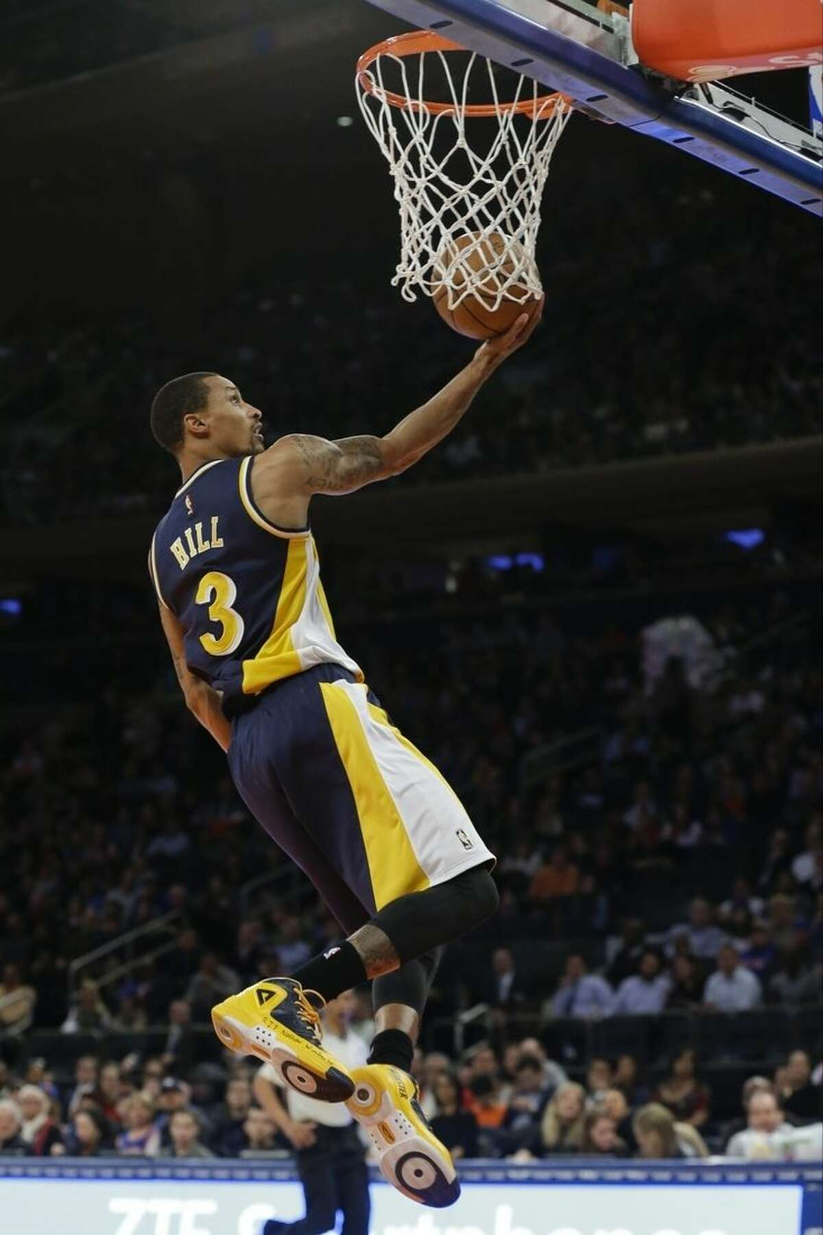 Indiana Pacers' George Hill (3) drives to the basket during the second half of an NBA basketball game against the New York Knicks Wednesday, April 8, 2015, in New York. (AP Photo/Frank Franklin II)