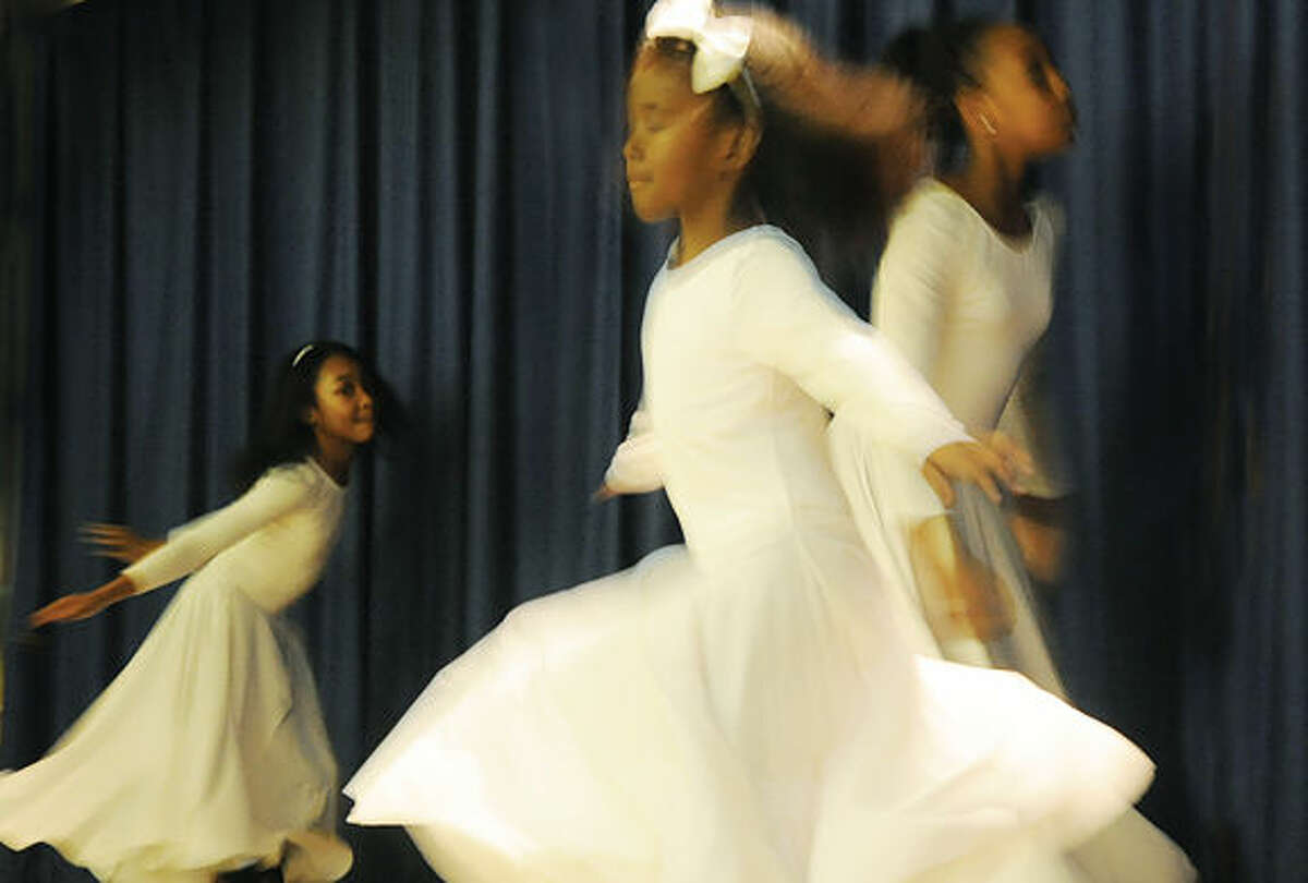 """Members of God's Angels Praise Dancers in the introduction of the last supper Sunday at Grace Baptist Church where Sunday school students performed """"Were You There When They Crucified My Lord?"""""""