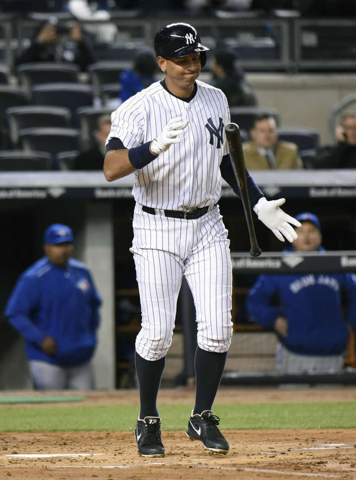 New York Yankees' Alex Rodriguez reacts after striking out to end the second inning of a baseball game against the Toronto Blue Jays Wednesday, April 8, 2015, at Yankee Stadium in New York. (AP Photo/Bill Kostroun)