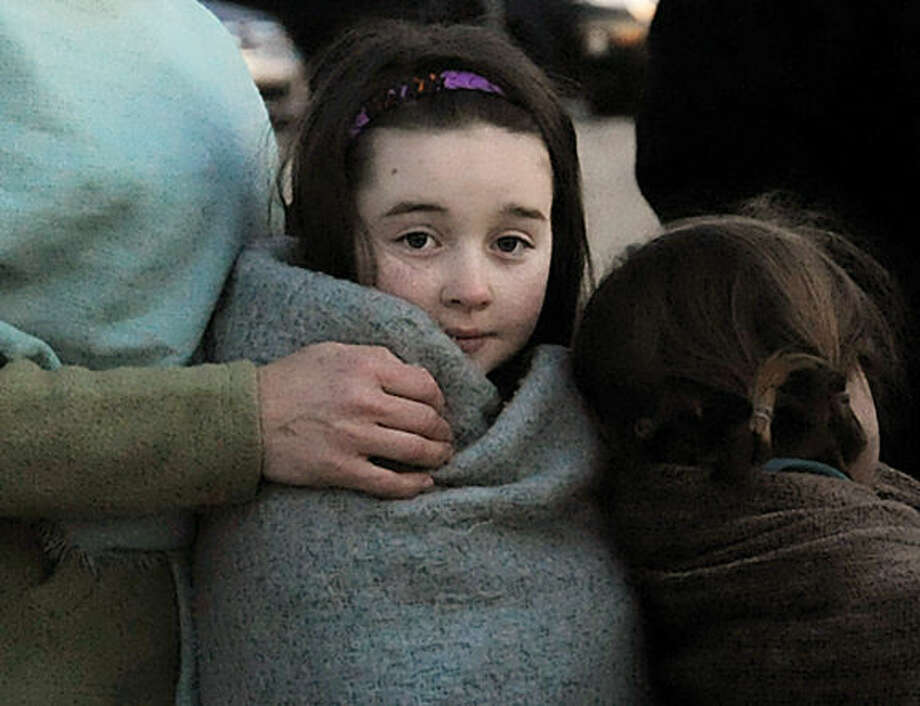 Adelia Purcell 9, bundled up at the sunrise service held on Easter Sunday at Compo Beach in Westport. Hour photo/Matthew Vinci
