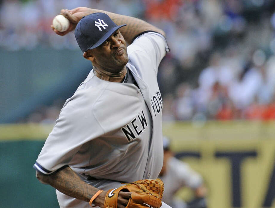 New York Yankees' CC Sabathia delivers a pitch against the Houston Astros in the first inning of a baseball game on opening day for the teams, Tuesday, April 1, 2014, in Houston. (AP Photo/Pat Sullivan)