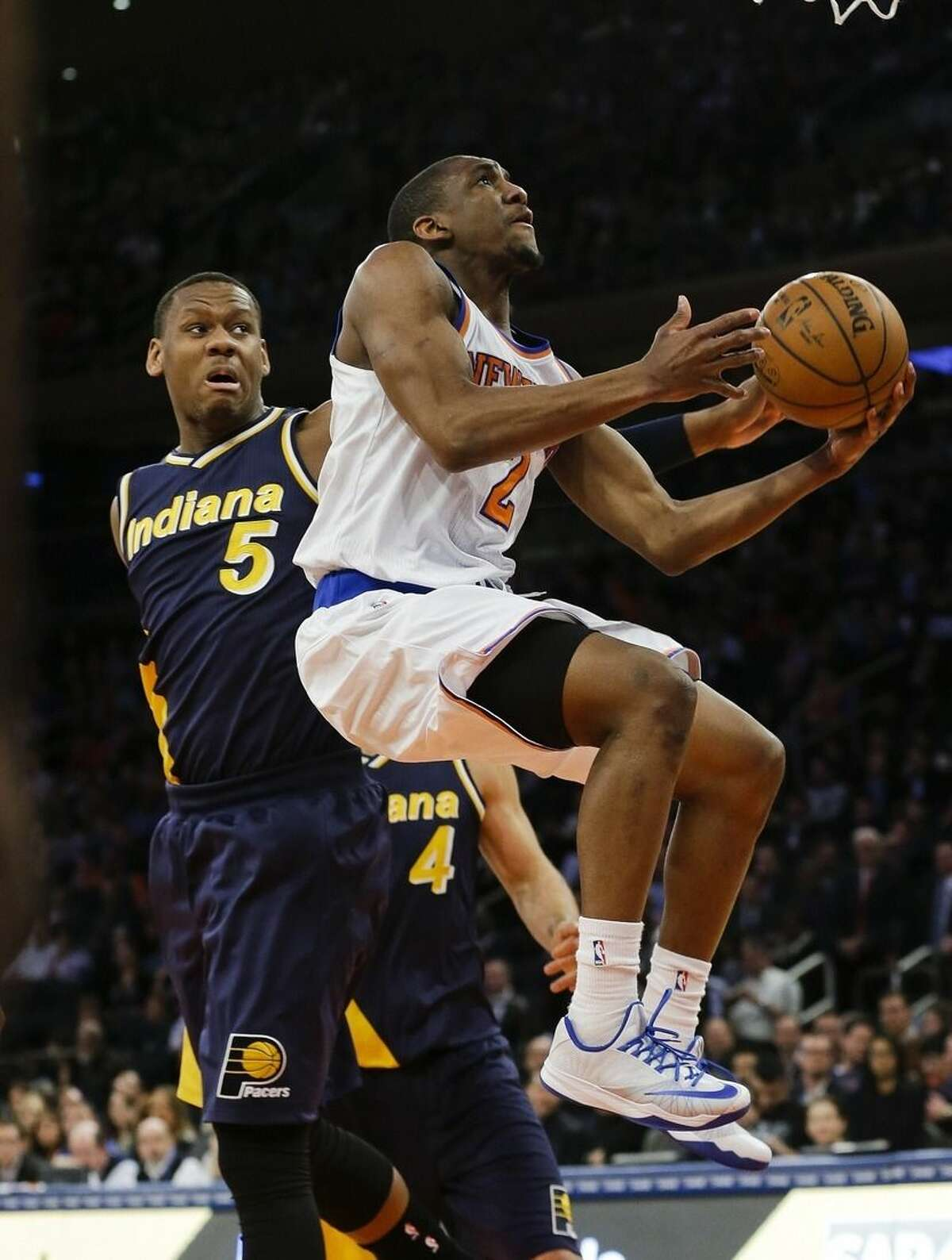 New York Knicks' Langston Galloway (2) drives past Indiana Pacers' Lavoy Allen (5) during the first half of an NBA basketball game Wednesday, April 8, 2015, in New York. (AP Photo/Frank Franklin II)