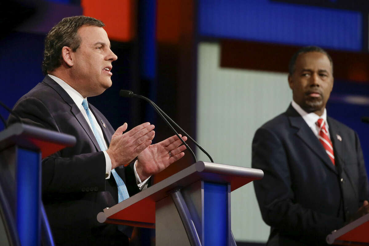 Republican presidential candidate New Jersey Gov. Chris Christie answers a question as retired neurosurgeon Ben Carson listens during a Republican presidential primary debate, Thursday, Jan. 28, 2016, in Des Moines, Iowa. (AP Photo/Charlie Neibergall)