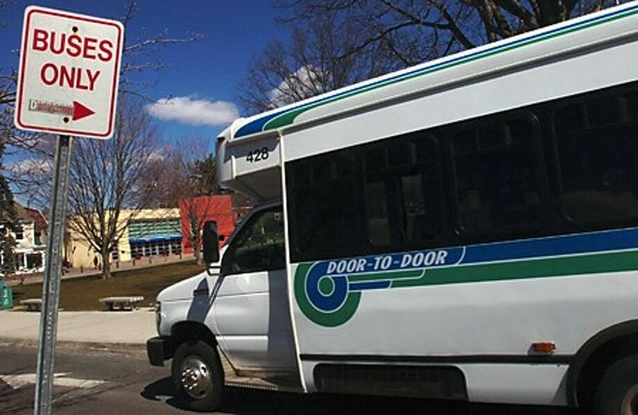 Norwalk Transit District bus service in Westport is threatened by the cutting of local funding. Hour photo / Erik Trautmann