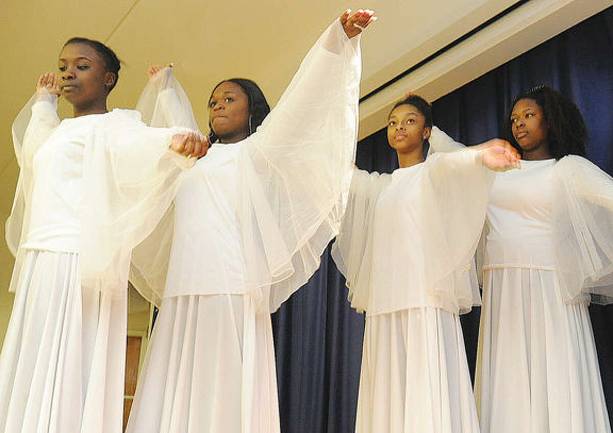 """Members of Imani Praise Dancers in a scene of the resurrection Sunday at Grace Baptist Church in Norwalk. Members of the Sunday school performed """"Were You There When They Crucified My Lord?"""" Hour photo/Matthew Vinci"""