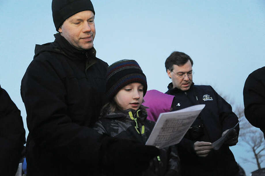 Craig Patton and his son Ian 9, at the Ecumenical Sunrise Service on Easter Sunday at Compo Beach in Westport. Hour photo/Matthew Vinci