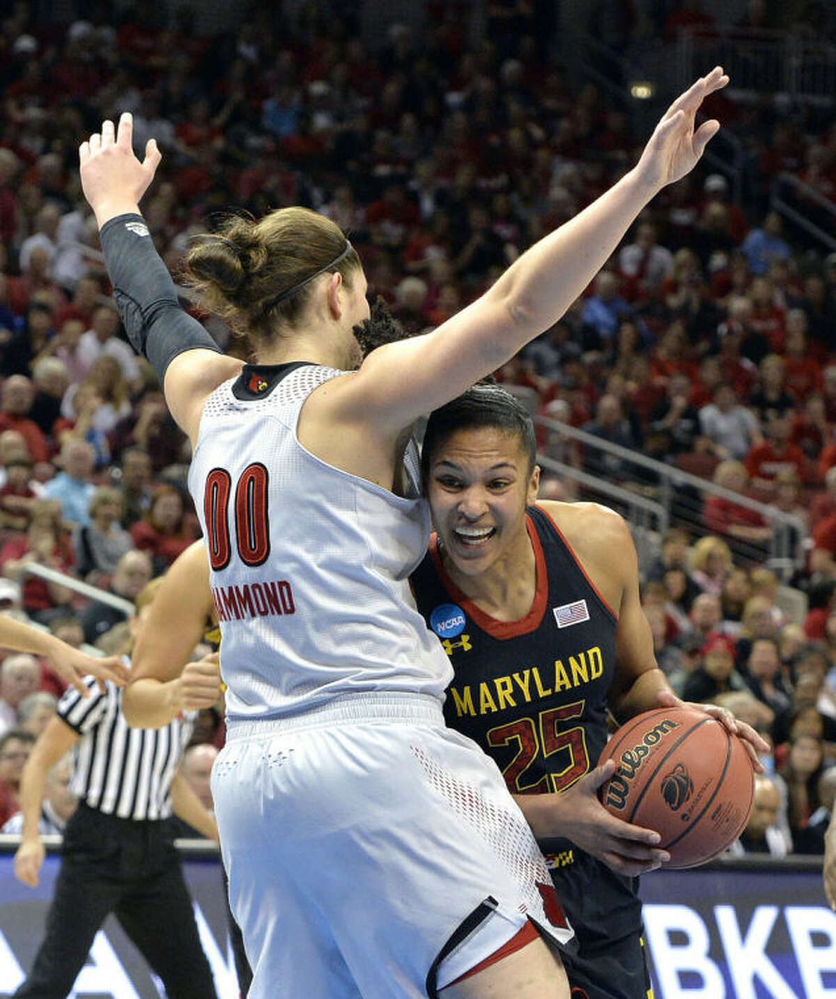 Maryland's Alyssa Thomas attempts to duck under the defense of Louisville's Sara Hammond during the first half of a regional final in the NCAA women's college basketball tournament, Tuesday, April 1, 2014, in Louisville, Ky. (AP Photo/Timothy D. Easley)