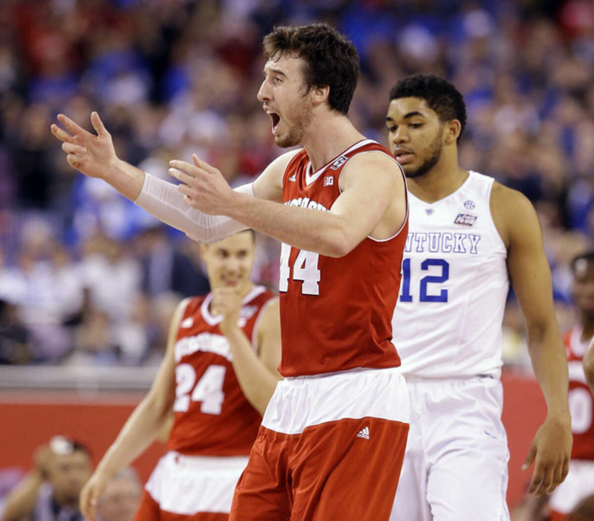 Wisconsin's Frank Kaminsky reacts during the second half of the NCAA Final Four tournament college basketball semifinal game against Kentucky Saturday, April 4, 2015, in Indianapolis. (AP Photo/Michael Conroy)