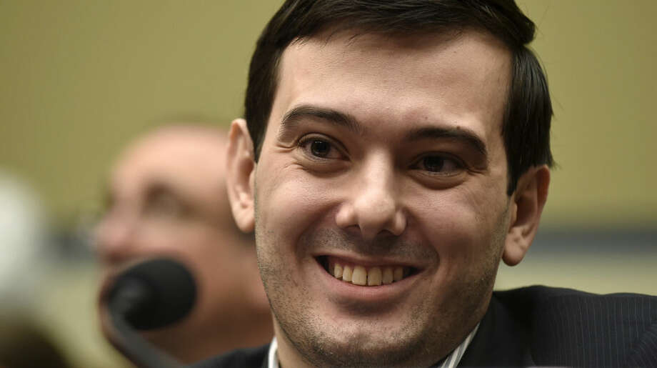 Pharmaceutical chief Martin Shkreli smiles on Capitol Hill in Washington, Thursday, Feb. 4, 2016, during the House Committee on Oversight and Reform Committee hearing on his former company's decision to raise the price of a lifesaving medicine. Shkreli refused to testify before U.S. lawmakers who excoriated him over severe hikes for a drug sold by a company that he acquired. (AP Photo/Susan Walsh)
